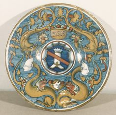 Plate Date: ca. 1525 Culture: Italian (Castel Durante: lustred in Gubbio) Medium: Maiolica (tin-enameled earthenware), lustered Dimensions: Overall (confirmed): 1 3/8 x 10 3/4 in. (3.5 x 27.3 cm) Classification: Ceramics-Pottery Credit Line: Gift of George Blumenthal, 1941 Accession Number: 41.100.277