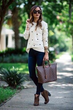 Cream polka dot sweater, skinny jeans, brown ankle boots.