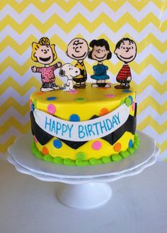 The Peanuts Gang (some of them).   Charlie Brown chevron stripe around the cake.