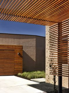 *architecture, outdoor spaces, walls, dividers* - Slatted wood trellis (IPE wood) and garage door