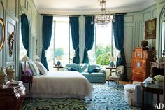 Timothy Corrigan's Spectacular French Château - In another guest room, the sofa is upholstered in a Manuel Canovas fabric from Cowtan & Tout, a Walter Gay painting surmounts the Swedish Biedermeier fall-front desk, and the needlepoint carpet is 19th-century Portuguese.