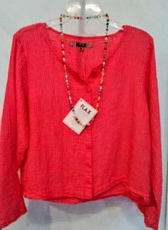"""BEST PRICE! WAS $86    Long-sleeved salmon with button front and scoop neck, the comfort and wearibility makes this blouse a stylish choice for your wardrobe.    Add a stone-beaded necklace for more panache! (was $30)    Derived from the latin word meaning """"most useful,"""" the flax plant is a highly sustainable resource with fibers that make durable, soft and very easy-to-wear clothing. Touted for the style and comfort, Flax garments are also known to be long-lasting. Due to the dying…"""