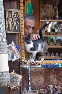 Not For Sale: A vendor and his cat at the Khan al Khalili bazaar, Cairo, Egypt.