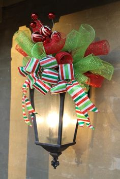Miss Kopy Kat - porch light deco.  She used two sets of the deco mesh spiral bundles to make the topper full.                                                                                                                                                     More