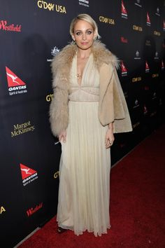 Nicole Richie wearing House of Harlow 1960 Four Elements Pendant Necklace, Alberta Ferretti Spring 2016 Ruched Chiffon Creponne Racerback Gown, House of Harlow 1960 Corona Stud Earrings, Opening Ceremony Patchwork Shearling Jacket and House of Harlow Heirloom Cocktail Ring
