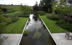 Could be functional and fun to have a patio area on one end of the pool YET I love the simplicity look of pure rectangle lap pool, with possibly a practical (narrow 3 foot) perimeter around it. tuinarchitect jacques van leuken