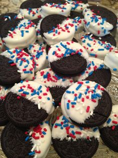 Patriotic Oreos covered in white sprinkled with red and blue. Sounds like a recipe for Memorial Day