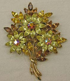 Brooch. Trifari  (American, founded 1918). Date: 1940–50 Culture: American Medium: metal, glass