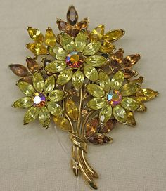 Brooch Trifari  (American, founded 1918)  Date:     1940–50 Culture:     American Medium:     metal, glass Dimensions:     Length: 3 1/2 in. (8.9 cm)