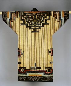 Embroidered coat made of textile (bark), cloth (silk). Ainu. Made in Sakhalin, Siberia. (via British Museum)