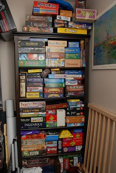 Our game cabinet was originally a storage for my scrapbook albums and supplies when we lived in Illinois and then again when we moved to Vir. Board Game Shelf, Board Game Storage, Dragon City Game, Board Game Organization, Closet Organization, Warehouse Plan, Bored Games, Playing Card Games, Store Displays