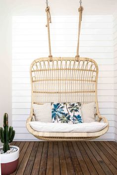 Rattan porch swing for two.