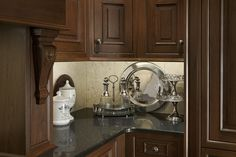 Elegant Traditions kitchen by #WoodMode, shown in Sable finish on walnut.