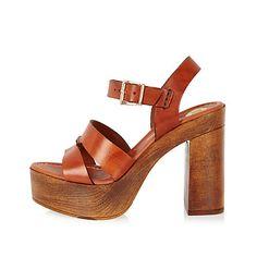 Brown leather heeled platforms $110.00