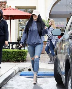 Got her own: Jenner rocked a tan dad hat with her Kylie Cosmetics signature lip logo ($35), by none other than The Kylie Shop