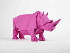 Sipho Mabona - Origami Animal / origami animated films here : http://www.mabonaorigami.com/en/videos/origami-rhino-unfolding.html