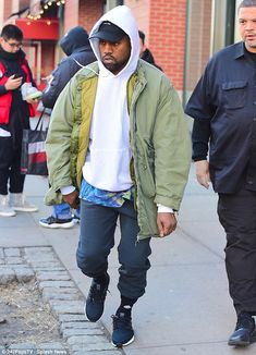Business time: It's going to be a busy week for Kanye West, who was spotted leaving his New York City apartment on Sunday ahead of the reveal of his new album AND new collection during New York Fashion Week