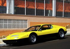 Ferrari 365 GT4 BB. It is produced between the 1973 to 1984 and used a mid-mounted flat-12cyl engine. It was designed by Leonardo Fioravanti.