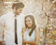 41-engaged-couple-smiles-sunlight-tree-branches-skinny-tie