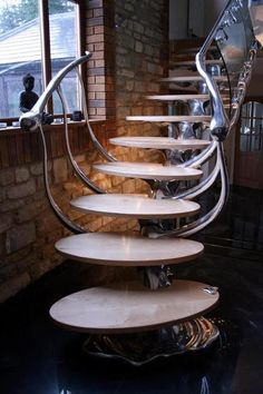 What better way to step forward and take control of your surroundings than to create an awesome interior design. We gathered some incredible examples of futuristic interior designs and hope you feel even more eager to work on your home. Modern Staircase, Grand Staircase, Staircase Design, Spiral Staircases, Staircase Ideas, Stair Steps, Stair Railing, Banisters, Metal Railings