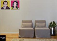 Il parquet in rovere è il comun denominatore di questo appartamento. Pochi dettagli molto curati sono stati scelti per cercare di aumentare la volumetria a livello visivo.   Toni naturali e quadri pop in contrasto.