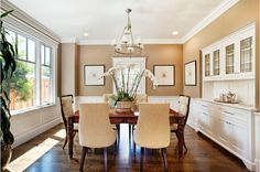Warm and bright dining room, with built-in hutch