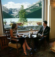 At Fairmont Chateau Lake Louise, Traditional English Tea is accompanied by scenic views of Lake Louise from the Fairview Dining Room.