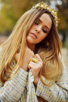 gold and pear crown with statement rings