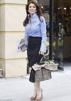 Pearl-Embellished Blue Blouse with Pencil Skirt: Lisa Vanderpump