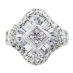 Vintage cluster ring with round, baguette, and princess-cut diamonds in white gold setting....