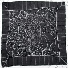 Quilting, Zentangle style.  Love the white thread on the black background.
