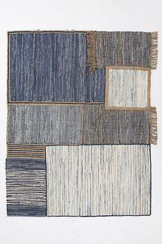 Denim patchwork rug for Anthroplogie. Grid of recycled denim. Cotton, jute. Imported.