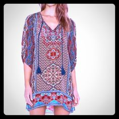 Ethnic design V neck 3/4 sleeves dress Ethnic design V neck 3/4 sleeves mini dress, polyester & cotton blend fabric is flowy & soft to touch, will fit as a loose Medium or a Large Dresses Mini