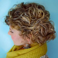 DIY HAIR FEATHER EXTENSIONS on curly hair  (by Stacie Stacie Stacie, via Flickr )