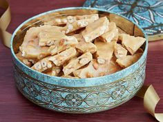 Peanut Brittle : Trisha says it's the baking soda that makes this peanut brittle so light and crunchy. Act quickly because once you add the baking soda, it's time to pour the mixture on the sheets to harden.