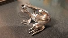 Stainless steel Frog made from recycled spoons and forks.