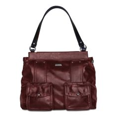 *Miche Canada*A burgundy faux leather shell two functional pocket in front. Her deep burgundy colour and side saddle styling makes Cheryl the must-have Shell this fall. Pair her with the latest in boots! She's casual yet sophisicated. Wear Cheryl with your favourite sweater and you're ready to walk amongst the trees or through the mall!