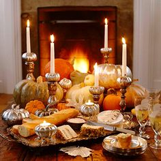 autumn tablescape. candle light and pumpkins with silver cheese platter