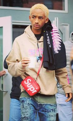 19-year-old Jaden Smith was spotted with his bleached blonde hair at the 2018 Sundance Film Festival carrying two bottles of water and showing off his SYRE fashion gear and a Louis Vuitton Supreme bag #JadenSmith #SYRE #SkateKitchen