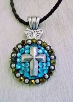 Beautiful western cowgirl cross concho necklace. Accented with genuine brown and aqua glass cryatals. $16.00  www.pamperedcowgirl.com