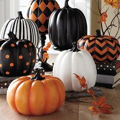 Not a fan of carving? A polka dotted faux pumpkin is a pretty alternative, especially when you place it alongside more fashionably patterned gourds.