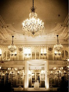 Finding the perfect venue is essential. Here, multiple chandeliers, elegant sconces and large antique lamps create an instantly breathtaking backdrop for this wedding reception.