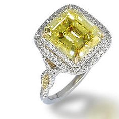 Set with an emerald-cut fancy intense yellow diamond, weighing 6.41 carats, within a double-tiered round brilliant-cut diamond surround, to openwork gallery and bifurcated shoulders set with colourless diamonds and diamonds of yellow hue, mounted in 18k yellow gold and platinum. Bonhams Hong Kong