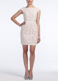 This short and sassy lace dress has tons feminine appeal!  Cap sleeve all over lace dart bodice with scoop neckline features dazzling tucked beaded waist.  Slim skirt with side pockets is ultra-chic.  Fully lined. Back zip. Imported polyester/cotton/nylon blend.  Hand wash cold. Wash dark colors separately. Do not wring or twist. No bleach. Lay flat to dry. Low iron.