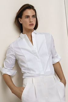 THE WHITE SHIRT - the hero staple, tuck this in to sleek white trousers to create a fresh office look.