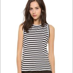 A.L.C Harper Twist Back tee striped A twisted knot drapes to reveal raw-edged cutouts on a striped jersey A.L.C. top. Banded scoop neckline and arm openings. Sleeveless.  Fabric: Jersey. 100% cotton. Hand wash. Made in the USA.  MEASUREMENTS Length: 22in / 56cm, from shoulder A.L.C. Tops Tank Tops