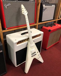 This Gibson Snow Falcon features a white finish on mahogany body and neck, white polymer coating on bound baked maple fretboard, white finish on headstock (front and back), and two white EMG pickups.