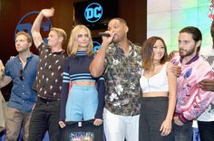 (L-R) Actors Jai Courtney, Joel Kinnaman, Cara Delevingne, Will Smith, Karen Fukuhara and Jared Leto from the cast of Suicide Squad film participates in an autograph session for fans in DC's 2016 Comic-Con booth at San Diego Convention Center on July 23, 2016 in San Diego, California.