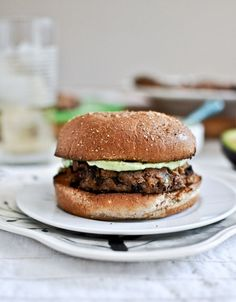 Easy Double Bean Burgers makes 6 burgers 1 (15 oz) can black beans, drained and rinsed 1 (15 oz) can cannellini beans, drained and rinsed 1 large egg + 1 large egg white, lightly beaten 1/2 cup panko bread crumbs 3 tablespoons olive oil 3 tablespoons fresh cilantro, chopped 4 garlic cloves, minced or pressed …