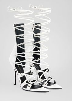 Bondage Lace-Up Sandals from Versace Women's Collection. Crafted from supple calf leather, these sandals draw inspiration from the House's rich rock'n'roll heritage. This lace-up style features a pointed toe and a high heel. White Sandals, Lace Up Sandals, Lace Up Heels, High Heels, Crazy Shoes, Me Too Shoes, Unique Heels, Shoe Boots, Shoes Heels